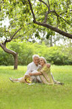 Amusing old couple on picnic. Portrait of Amusing old couple on picnic Royalty Free Stock Images