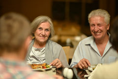 Amusing old couple. Portrait of a amusing old couple in cafe stock images