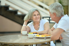 Amusing old couple. Portrait of a amusing old couple in cafe royalty free stock images