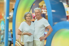 Amusing old couple. Portrait of amusing old couple in shopping mall royalty free stock photography