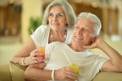 Amusing old couple. On vacation drinking cocktail stock photo