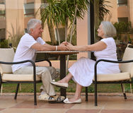 Amusing old couple. On vacation at table stock photography