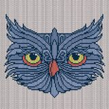 Amusing Owl with big yellow eyes. Knitting grayish Owl with big yellow eyes on the white background, vector pattern as a fabric texture Royalty Free Stock Photo
