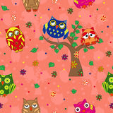 Amusing owls seamless pattern over terracotta Royalty Free Stock Photo
