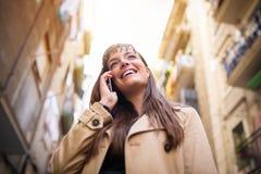 Amusing phone conversation Royalty Free Stock Photos