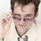 Amusing portrait of artful man with spectacles Royalty Free Stock Photos