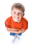 Amusing portrait of the boy with the crossed hands Royalty Free Stock Photo