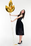 Amusing positive lovely female posing with star shaped balloons Royalty Free Stock Image