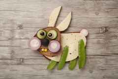 Amusing rabbit made of bread and vegetables Royalty Free Stock Image