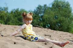 Amusing red-haired girl resting on beach Stock Images