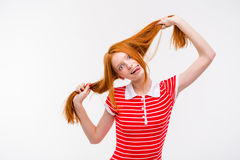 Amusing redhead young woman showing tongue and having fun Stock Photography