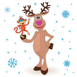 Amusing reindeer holding a small monkey Royalty Free Stock Photos