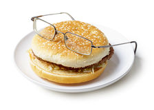 Amusing sandwich in spectacles isolated on a white Royalty Free Stock Photos