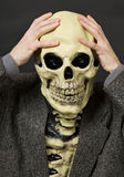 Amusing scared person in mask - skull Royalty Free Stock Photos