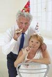 Amusing senior couple partying Stock Images