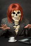 Amusing skeleton with red hair - Halloween royalty free stock image