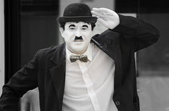 Street perfomer in Charlie Chaplin costume. An amusing street performer in Europe entertaining the people and tourists on the main city streets of France.  He is Royalty Free Stock Photography