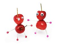 Amusing sweet cherry. Two amusing little men collected from a sweet cherry royalty free stock photos