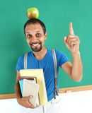 Amusing teacher literature with an apple on her head. Stock Photography