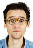 Amusing tousled man in old ridiculous spectacles. The amusing tousled man in old ridiculous spectacles isolated on white Stock Image