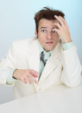 Amusing tousled scared person in white jacket Stock Image