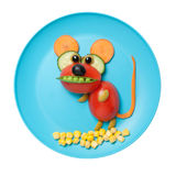 Amusing vegetable mouse made on blue plate Royalty Free Stock Photos