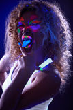 Amusing visage model posing in UV light Stock Photo