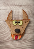 Amusing wolf made of bread. On wooden background royalty free stock photography