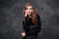 Amusing woman with long curly hair making funny duck face Royalty Free Stock Photos