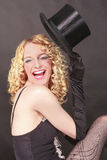 Amusing woman with top hat Stock Photo