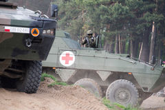 AMV XC-360P Rosomak armored vehicle with armored medical support Royalty Free Stock Photography