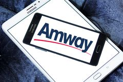 Amway company logo. Logo of Amway company on samsung mobile. Amway is an American company specializing in the use of multi-level marketing to sell health, beauty royalty free stock images