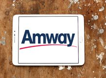 Amway company logo. Logo of Amway company on samsung tablet. Amway is an American company specializing in the use of multi-level marketing to sell health, beauty stock photography