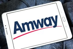 Amway company logo. Logo of Amway company on samsung tablet. Amway is an American company specializing in the use of multi-level marketing to sell health, beauty royalty free stock image