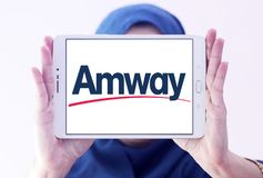 Amway company logo. Logo of Amway company on samsung tablet holded by arab muslim woman. Amway is an American company specializing in the use of multi-level royalty free stock photos