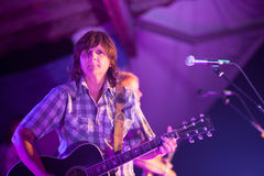 Amy Ray of Indigo Girls Plays Guitar. HOT SPRINGS, NC - AUGUST 10: The Indigo Girls partner Amy Ray plays guitar on stage at the Wild Goose Festival at night on stock image