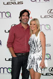 Amy Smart, Carter Oosterhouse. LOS ANGELES - OCT 15:  Carter Oosterhouse, Amy Smart arriving at the 2011 Environmental Media Awards at the Warner Brothers Studio Royalty Free Stock Photography