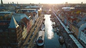 Amzing Backlight sunset footage from Copenhagen, Denmark. bridge in Nyhavn New Harbour canal and entertainment district