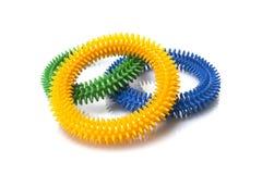 Anéis azuis, amarelos e verdes da massagem Fotos de Stock
