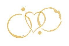 Anéis da mancha dos cafés e coração do amor Imagens de Stock