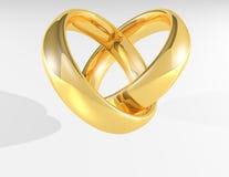 Anéis de casamento do ouro do coração Foto de Stock Royalty Free