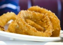 Anéis de cebola fritados Fotos de Stock Royalty Free