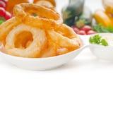 Anéis de cebola fritados dourados Fotografia de Stock