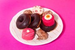 Anéis de espuma e pequenos doces quatro Fotos de Stock