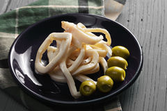 Anéis do calamar e azeitonas verdes Foto de Stock Royalty Free