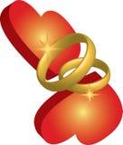 Anéis e corações de casamento Foto de Stock