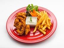Anéis fritados do calamar com batatas fritas Fotografia de Stock