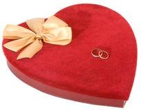Anéis no coração Fotos de Stock Royalty Free