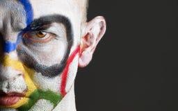 Anéis olímpicos pintados no homem da face fotografia de stock royalty free