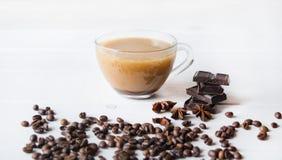 Anís, café y chocolate negro en la tabla fotos de archivo libres de regalías